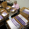 A election worker looks over ballots at the Multnomah County Elections Building Tuesday, Nov. 2, 2010, in Portland, Ore.  (AP Photo/Rick Bowmer)