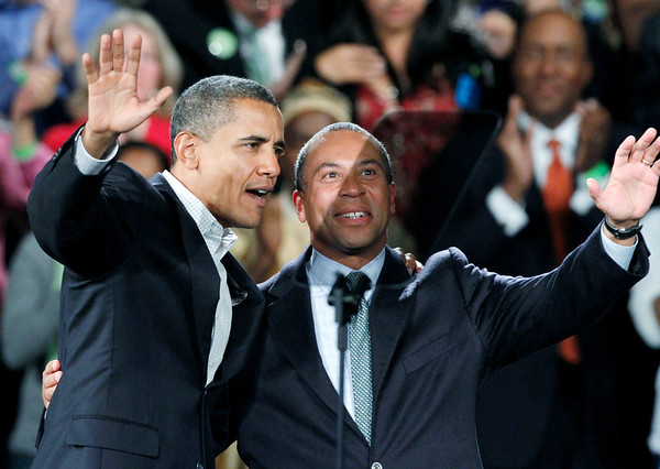 President Barack Obama and Massachusetts Gov. Deval Patrick wave to the crowd during a campaign rally for Patrick at the Hynes Convention Center in Boston, Saturday, Oct. 16, 2010. (AP Photo/Michael Dwyer)