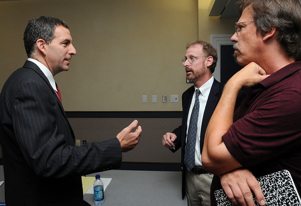 From left, Beverly Democratic state representative candidates Jerry Parisella and Scott Houseman, speak with Beverly resident, Tony Toledo, just before the start of the Beverly Democratic state representative debate between Jerry Parisella and Scott Houseman at the Beverly Public Library.<br /> Photo by Ken Yuszkus/Salem News, Tuesday,  September 7, 2010.