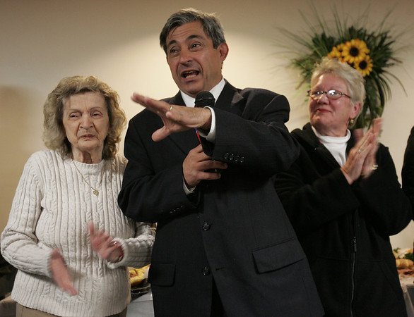 State Representative Ted Speliotis speaks to his supporters at the Polish Club in Danvers Tuesday evening. Next to Speliotis is his mother, Carol, left, and his wife June. Photo by deborah parker/november 2, 2010
