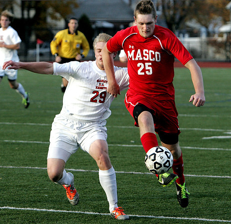 Lynn:<br /> North Andover's Michael Canale, left, closes in on Masconomet's Edison Forbes during the North Andover vs. Masco boys soccer North final at Manning Field in Lynn.<br /> Photo by Ken Yuszkus / The Salem News, Monday, November 11, 2013.