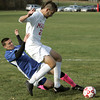 Topsfield:<br /> Danvers' Jon Giacalone falls under Masco's Jeffrey Panella during the Danvers at Masconomet boys soccer in Division 2 North quarterfinals.<br /> Photo by Ken Yuszkus / The Salem News, Tuesday, November 5, 2013.