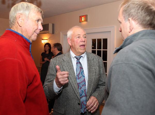 Ipswich: 2013 Ipswich High School Athletic Hall of Fame Inductee Rick Storer, center, talks with Hank Spellman, left, and Ben Paul, of Ipswich on Friday evening. David Le/Salem News