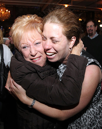 Salem: Nita Ludensky, of Salem, left, gives newly elected Ward 6 Councilor Beth Gerard, right, after she upset incumbent Councilor Paul Prevey to capture the seat on Tuesday evening. David Le/Salem News