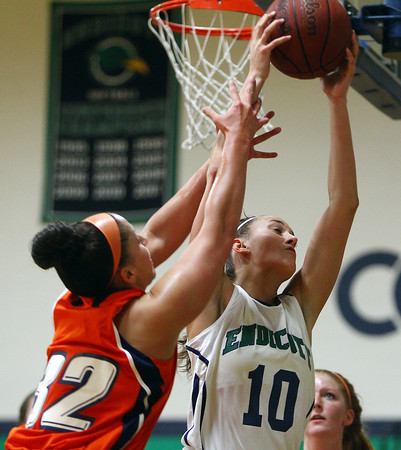 Beverly: Endicott sophomore forward Kelsey Cuddy (10) battles with Salem State senior captain Ginny Fleming (32) for a rebound during the first half of play on Thursday evening. David Le/Salem News
