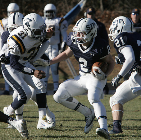 Danvers:<br /> St. Johns Prep's Owen Rockett sidesteps the Xaverian's defense during the Xaverian at St. John's Prep Thanksgiving football game.<br />  Photo by Ken Yuszkus / The Salem News, Thursday, November 28, 2013.