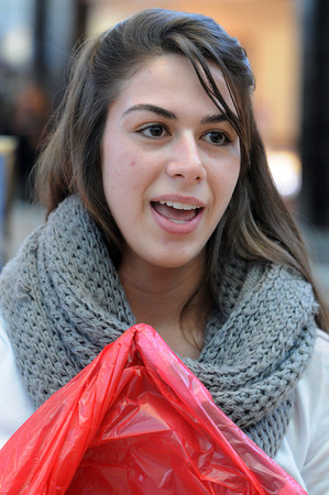 Peabody:<br /> Cristian Faia speaks about Black Friday while shopping at the North Shore Mall.<br /> Photo by Ken Yuszkus / The Salem News, Wednesday, November 13, 2013.