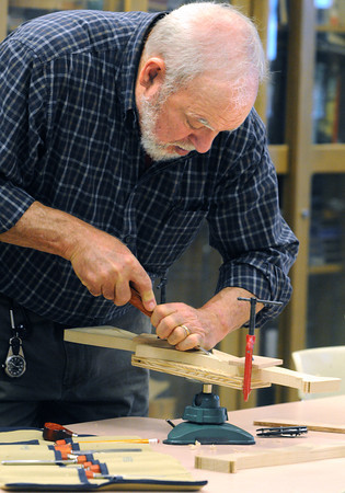 Peabody:<br /> Tony Schettino of Salem carves one of the legs for his 5 legged table during the wood carving activity at the Torigian Community Life Center in Peabody.<br /> Photo by Ken Yuszkus / The Salem News, Wednesday, November 6, 2013.