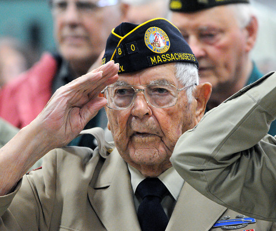 Danvers:<br /> WWII veteran Bob Flachbart salutes during the pledge of allegiance during the Danvers Veterans Council dedication of the memorial at the Veterans Memorial fields at the Thorpe School.<br /> Photo by Ken Yuszkus / The Salem News, Monday, November 11, 2013.