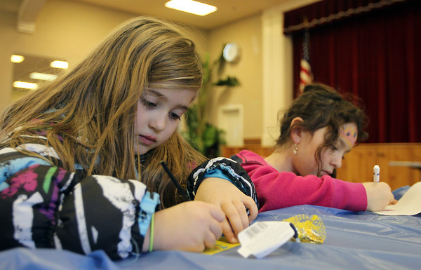 Peabody: Mia Kent, 7, left, and Rochel Schusterman, 8, work on Hannukah themed artwork at the first annual Hannukah celebration held at the Knights of Colombus on Main St. in Peabody on Friday morning. David Le/Salem News