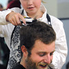 Beverly:<br /> Teacher Charlie Juliand gets a haircut from Annie Curtin in front of students and faculty of St. Mary School.<br /> Photo by Ken Yuszkus / The Salem News, Monday, November 18, 2013.