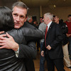 Beverly:<br /> Beverly mayoral candidate Mike Cahill hugs his campaign manager Julie Desilva while wading through the crowd after Cahill won.<br /> Photo by Ken Yuszkus / The Salem News, Tuesday, November 5, 2013.