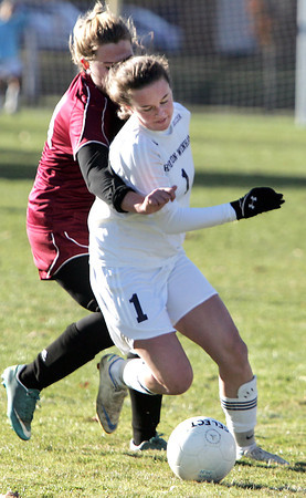 Hamilton:<br /> Hamilton-Wenham's Caroline Gribbell has a Weston goalie on her back while moving the ball at the Weston at Hamilton-Wenham girls soccer Division 3 North playoff quarterfinal game.<br /> Photo by Ken Yuszkus / The Salem News, Monday, November 4, 2013.