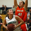 Beverly: Endicott junior forward Kayleen Whall (21) tries to get past Salem State freshman Malissa Saad (41) on Thursday evening. David Le/Salem News