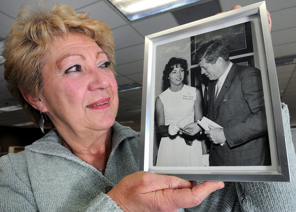 Beverly:<br /> Donna Kendall of Danvers holds a photo of herself with President Kennedy. Donna Kendall was a YMCA Youth Governor in 1962, and was the delegate from Massachusetts to visit the White House during the summer of 1962. While there, she met President Kennedy and was able to give him a token from the YMCA.<br /> Photo by Ken Yuszkus / The Salem News, Wednesday, November 20, 2013.