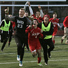 Lynn:<br /> Willie Stewart leads the Masconomet players down the field while rejoicing after just winning the North Andover vs. Masco boys soccer North final at Manning Field in Lynn.<br /> Photo by Ken Yuszkus / The Salem News, Monday, November 11, 2013.