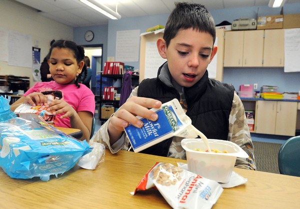 Salem:<br /> Students Luz Disla and Elliot McArthur dig into their breakfasts in their classrooms at the Carlton Elementary School. The Salem Public Schools have started a grant-funded breakfast in the classroom program.<br /> Photo by Ken Yuszkus / The Salem News, Friday, November 22, 2013.