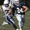 Danvers:<br /> St. Johns Prep's Owen Rockett is closely followed by Xaverian's Shayne Kaminski during the Xaverian at St. John's Prep Thanksgiving football game.<br />  Photo by Ken Yuszkus / The Salem News, Thursday, November 28, 2013.