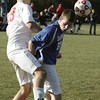 Topsfield:<br /> Masco's Alex Spaulding, left, and Danvers' Mark McCarthy fight over a loose ball that bounced off Masco's Alex Spaulding's chest during the Danvers at Masconomet boys soccer in Division 2 North quarterfinals.<br /> Photo by Ken Yuszkus / The Salem News, Tuesday, November 5, 2013.