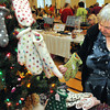 Beverly:<br /> Pat Carpenter looks at some knitted mittens on sale at the holiday craft fair held at the Beverly Senior Center. She recently moved to Beverly from South Africa and is in need of some warm mittens.<br /> Photo by Ken Yuszkus / The Salem News, Thursday, November 7, 2013.