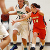 Beverly: Endicott senior captain Samantha Crough (23) carries the ball up court against Salem State senior guard Ashley White (14) on Thursday evening. David Le/Salem News