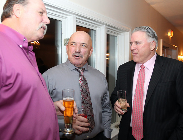 Ipswich: 2013 Ipswich High School Athletic Hall of Fame Inductee Carl Mattarocchia, center, talks with Jim Dort, left, of Ipswich and Norman Chambers, of Houston, TX, on Friday evening. David Le/Salem News