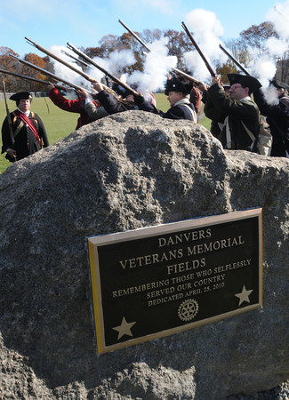 Danvers:<br /> The Danvers Alarm List Company fires a salute near the conclusion of the Danvers Veterans Council dedication of the memorial at the Veterans Memorial fields at the Thorpe School. The new memorial is in the foreground.<br /> Photo by Ken Yuszkus / The Salem News, Monday, November 11, 2013.