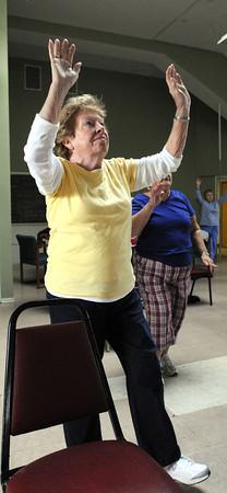 Salem:<br /> Claire Hosman stretches upward while participating in the Enhanced Fitness program at the Salem Senior Center.<br /> Photo by Ken Yuszkus / The Salem News, Friday, November 8, 2013.