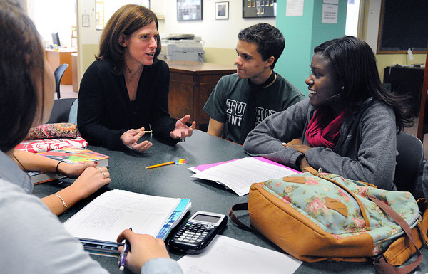 Salem:<br /> From left, Salem Academy Charter School head of school and founder Rachel Hunt speaks with students Dominic Serino and Edwina Shackleton.<br /> Photo by Ken Yuszkus / The Salem News, Thursday, November 14, 2013.