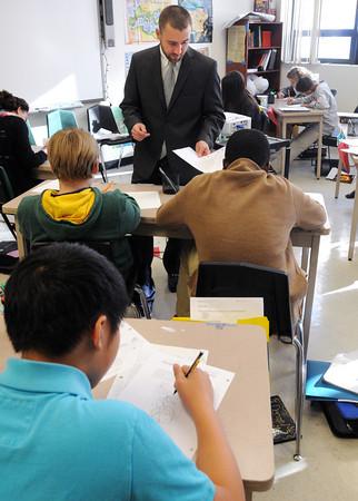 Salem:<br /> Salem Academy Charter School teacher William Camp checks the homework of his Ancient Civilization 7th grade class.<br /> Photo by Ken Yuszkus / The Salem News, Thursday, November 14, 2013.