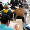Salem:<br /> Salem Academy Charter School teacher William Camp checks the homework of his Ancient Civilization 7th grade class.<br /> Photo by Ken Yuszkus / The Salem News, Thursday, November 14, 2013.