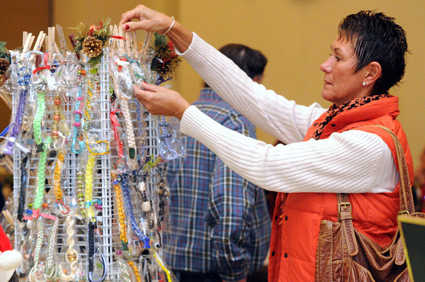 Beverly:<br /> Diane Vercollone of Beverly examines some bracelets on sale at the holiday craft fair held at the Beverly Senior Center.<br /> Photo by Ken Yuszkus / The Salem News, Thursday, November 7, 2013.