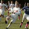 Topsfield:<br /> Masco's Greg Dougherty keeps possession of the ball with Danvers' Brandon Hyde at his heels during the Danvers at Masconomet boys soccer in Division 2 North quarterfinals.<br /> Photo by Ken Yuszkus / The Salem News, Tuesday, November 5, 2013.
