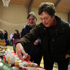 Beverly: Judy Urbanski, of Danvers, and Kaitlyn Gregory, 15, of Ipswich, look at assorted jams at the annual Beverly Holiday Fair on Saturday morning. David Le/Salem News
