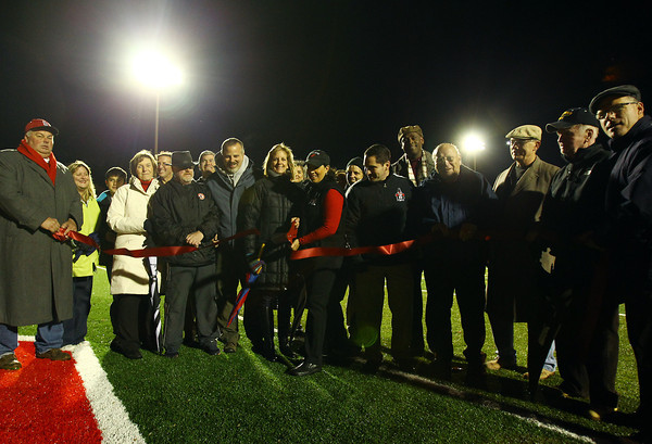 Salem: Salem Mayor Kim Driscoll, center, cuts the ribbon to officially open the newly renovated Bertram Field prior to the start of the Witches game on Friday evening. David Le/Salem News