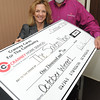 Beverly:<br /> Regional publisher Karen Andreas receives a check for $1000 from Brian Cranney of Cranney Home Services at The Salem News on Tuesday afternoon.<br /> Photo by Ken Yuszkus / The Salem News, Tuesday, November 12, 2013.