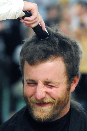 Beverly:<br /> Teacher Charlie Juliand grimmaces as he gets a haircut from Annie Curtin in front of students and faculty of St. Mary School.<br /> Photo by Ken Yuszkus / The Salem News, Monday, November 18, 2013.