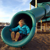 Marblehead: Savannah Caruso, 6, of Marblehead braces herself for the cold air as she shoots out of a slide at Devereaux Beach in Marblehead on Thursday afternoon. David Le/Salem News