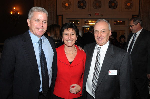 Danvers:<br /> From left, Mike Ward of Insight, Nicole McLaughlin of Plummer Home, and Al Dichner of R&L Associates, attend the North Shore Chamber of Commerce annual dinner held at Danversport Yacht Club.<br /> Photo by Ken Yuszkus / The Salem News, Tuesday, November 19, 2013.