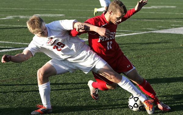 Lynn:<br /> North Andover's Michael Canale, left, and Masconomet Adam Grammer really lean in to try to snag the ball during the North Andover vs. Masco boys soccer North final at Manning Field in Lynn.<br /> Photo by Ken Yuszkus / The Salem News, Monday, November 11, 2013.