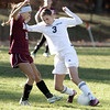 Hamilton:<br /> Hamilton-Wenham's Emma Beane, right, controls the ball past a Weston player at the Weston at Hamilton-Wenham girls soccer Division 3 North playoff quarterfinal game.<br /> Photo by Ken Yuszkus / The Salem News, Monday, November 4, 2013.