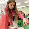 Beverly: Chloe Beaupre, 7, of Beverly, picks out some stickers to decorate her ornament bag at the annual Beverly Holiday Fair at the First Baptist Church on Saturday morning. David Le/Salem News