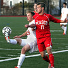 Lynn:<br /> North Andover's Michael Canale, left, and Masconomet's Adam Grammer wrestle for the ball during the North Andover vs. Masco boys soccer North final at Manning Field in Lynn.<br /> Photo by Ken Yuszkus / The Salem News, Monday, November 11, 2013.