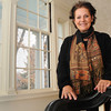 Danvers:<br /> Sandra Biondo, member of of the Danvers Historical Society and interior designer, helped select designers for the redecoration of the Endicott Mansion. She is standing on the main staircase at the Endicott Mansion. The Danvers Historical Society is celebrating its 50th year of owning the Endicott Mansion (originally built in 1820 or so) by inviting designers to re-design the interior in a manner that recalls it's heydey, from the 1890s to the 1930s,<br /> Photo by Ken Yuszkus / The Salem News, Friday, November 22, 2013.
