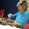 Peabody:<br /> Alicia Mills works on her project during the rug hooking activity at the Torigian Community Life Center in Peabody.<br /> Photo by Ken Yuszkus / The Salem News, Wednesday, November 6, 2013.