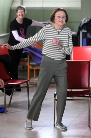 Salem:<br /> Mary McLean exercises to the music in the Enhanced Fitness program at the Salem Senior Center.<br /> Photo by Ken Yuszkus / The Salem News, Friday, November 8, 2013.