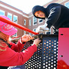 Salem: Pam Rochna and Dave Wettengel, two parents of Saltonstall School students, work to assemble a jungle gym on Saturday morning. A bunch of volunteers worked all day Saturday to complete a playground which was not in the Saltonstall School renovation plans after the playground was burned down in 2010. David Le/Salem News