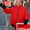 Beverly:<br /> Beverly mayoral candidate Wes Slate waves to motorists at the foot of the bridge on Cabot Street at dusk.<br /> Photo by Ken Yuszkus / The Salem News, Monday, November 4, 2013.