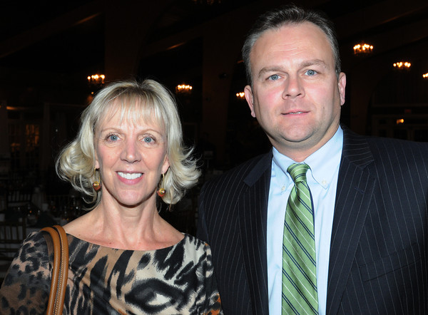Danvers:<br /> Lynn Cantwell and Eric Kuharich, both of People's United Bank, attend the North Shore Chamber of Commerce annual dinner held at Danversport Yacht Club.<br /> Photo by Ken Yuszkus / The Salem News, Tuesday, November 19, 2013.