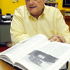 Danvers:<br /> Danvers archivist Richard Trask will give a talk about the JFK assassination at the Danvers Historical Society on Nov. 14. Opened before him is one of his books on the subject.<br /> Photo by Ken Yuszkus / The Salem News, Wednesday, November 6, 2013.